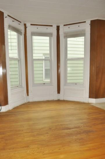 Hardwood floors found under 1960's shag carpeting.