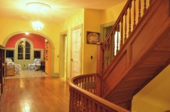 Second Level Hallway, stairs go up to Yoga Loft Studio and down to main level hallway