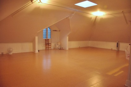 Third Level, currently used as a Yoga Studio, there is the full level, and a full bathroom in this space.